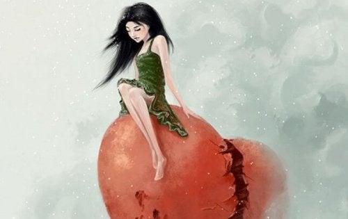 Pige der sidder paa en knust hjerte