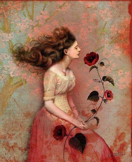 Kvinde der sidder med en lan rosenblomst