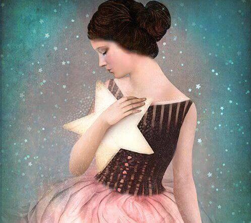 Pige der holder en stjerne