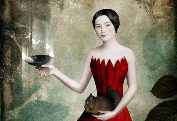 Kvinde holder et egern