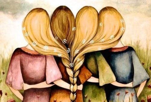 4 piger med ryggen til