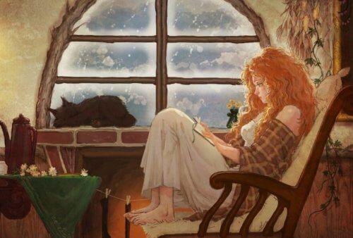 Billede af en ung kvinde der sidder og laeser