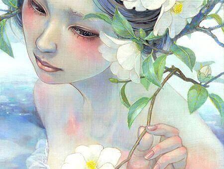 Ung kvinde og en blomst