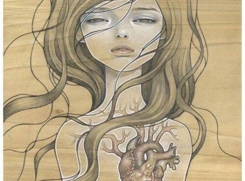 Tegning af hjerte i kvinde