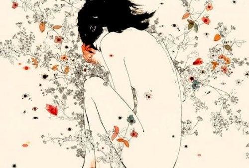 Kvinde uden toej og blomster