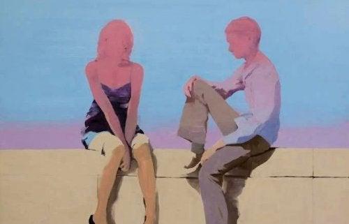 Kærestepar på en mur