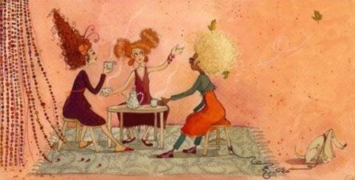 Tre kvinder drikker te