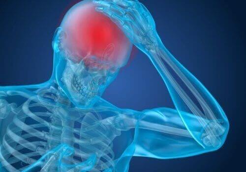 Illustration af person med hovedpine